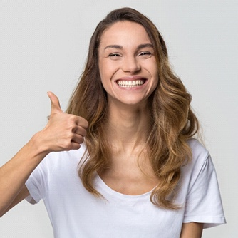 young woman giving a thumbs up