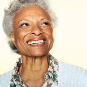 Senior woman with a beautiful smile thanks to the implant dentist Farmington residents rely on