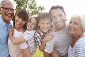 family smiling dental care