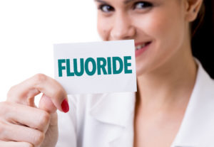 Woman holding a fluoride sign