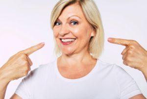 Woman with dental implants in Farmington