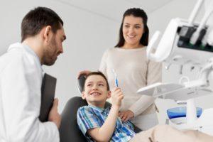 Mom and child at dentist in Farmington