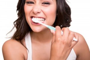 woman practicing excellent oral hygiene